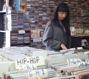 Valarie Ramos shops through Spindles record store. Andrew Meer/The Telescope