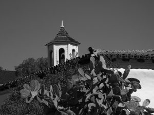 Cacti in front of churchbell in Old Town San Diego.