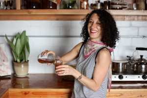 Sonia Weksler pours some of the homemade kombucha she made at her store in North Park, Sleep Bedder/Sommeil.